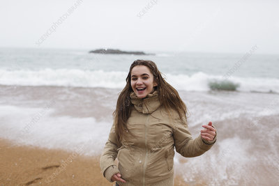 Portrait happy, carefree girl on beach