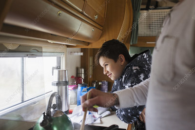 Father and soon cooking in motor home