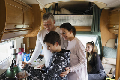 Family cooking in motor home