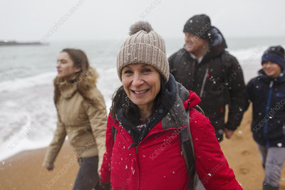 Portrait woman with family on snowy beach