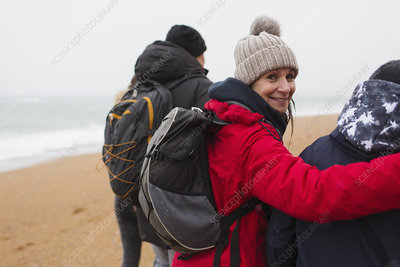 Woman with husband and son on winter beach