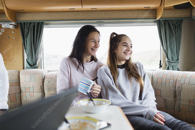 Mother and daughter eating in motor home