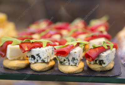 Canapes with blue cheese and garnish