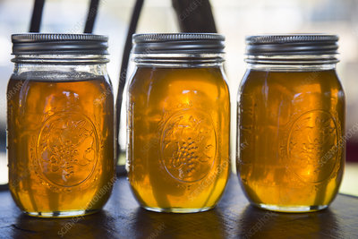 Close up of three glass jars with honey