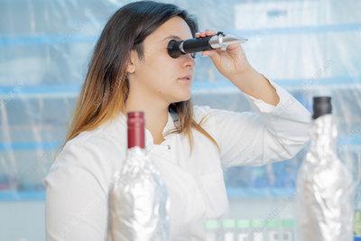Testing wine in quality control lab