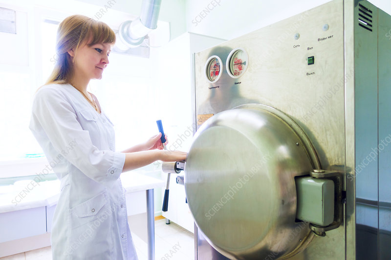 Technician working autoclave