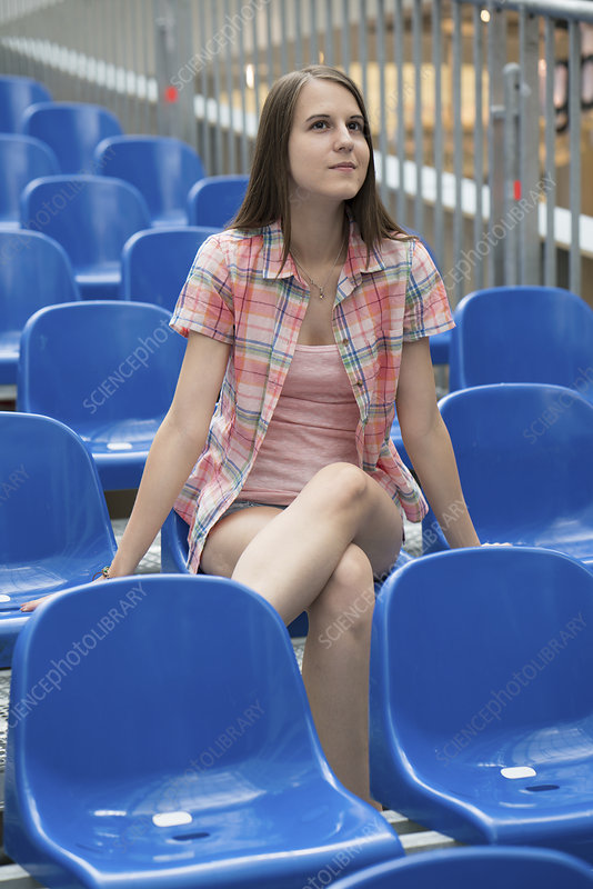 Woman sitting in arena