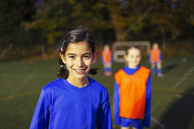 Portrait girl playing soccer