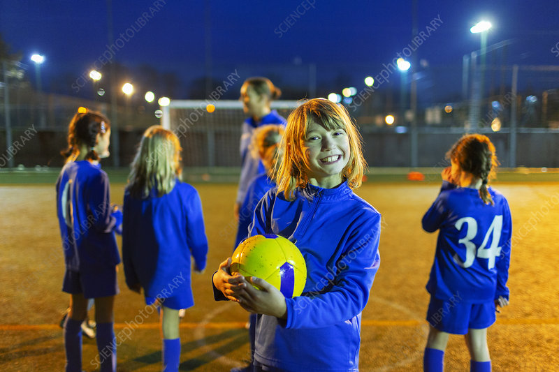 Portrait smiling, girl enjoying soccer practice