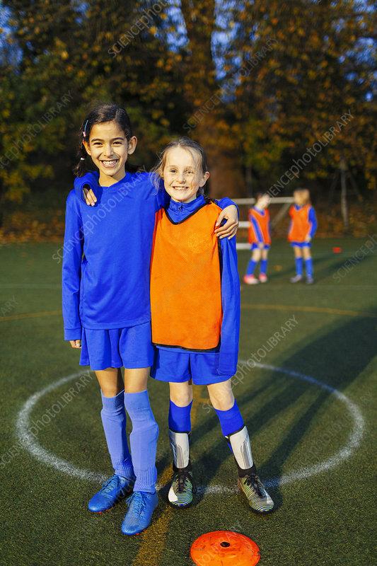 Portrait smiling, girl soccer players