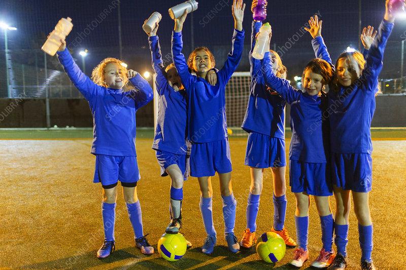 Portrait girls soccer team with water bottles
