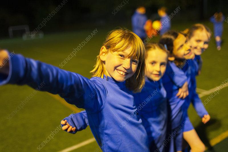 Portrait smiling, girls soccer team
