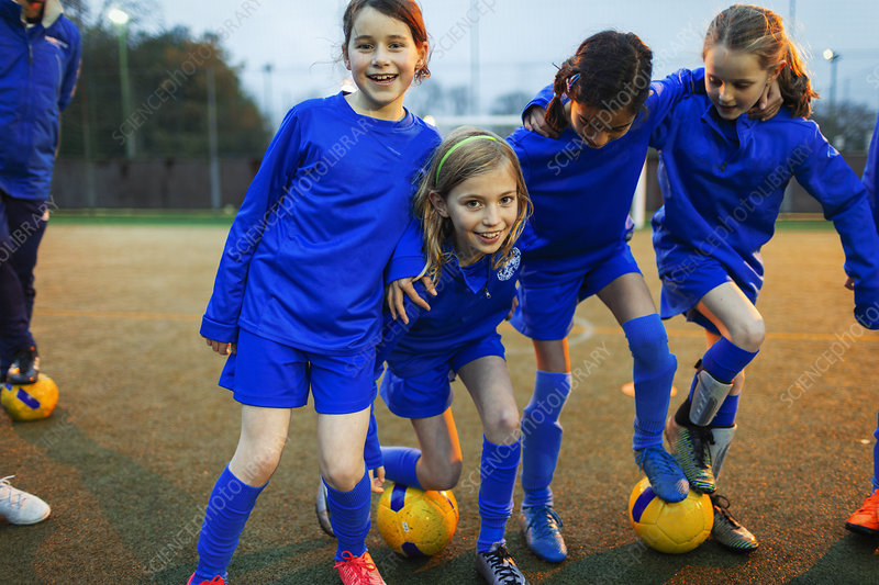 Portrait happy girls soccer team