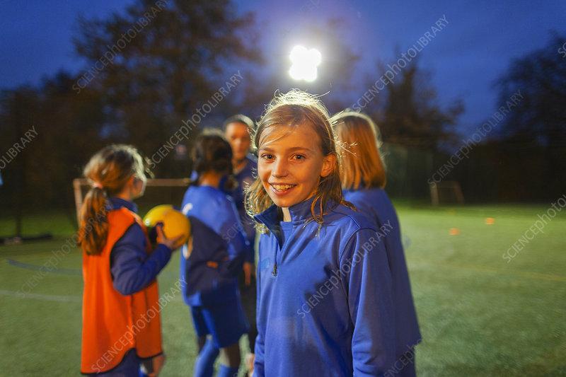 Portrait smiling, girl soccer player