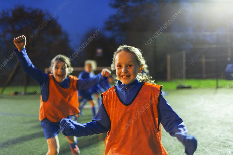 Portrait girl soccer players cheering