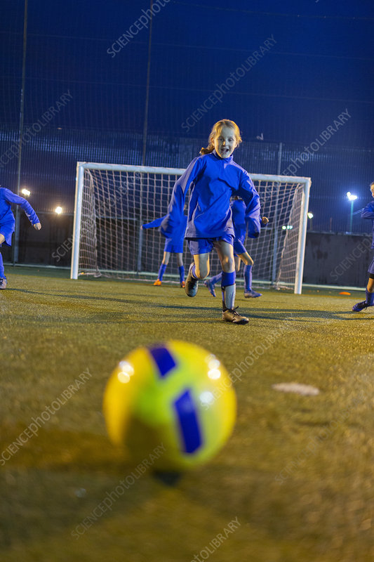 Girl soccer player practicing