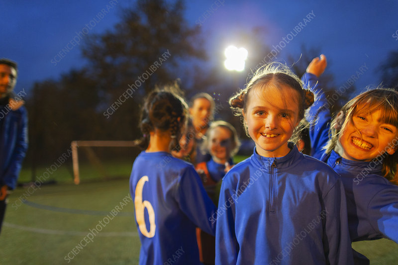 Portrait happy girl soccer players