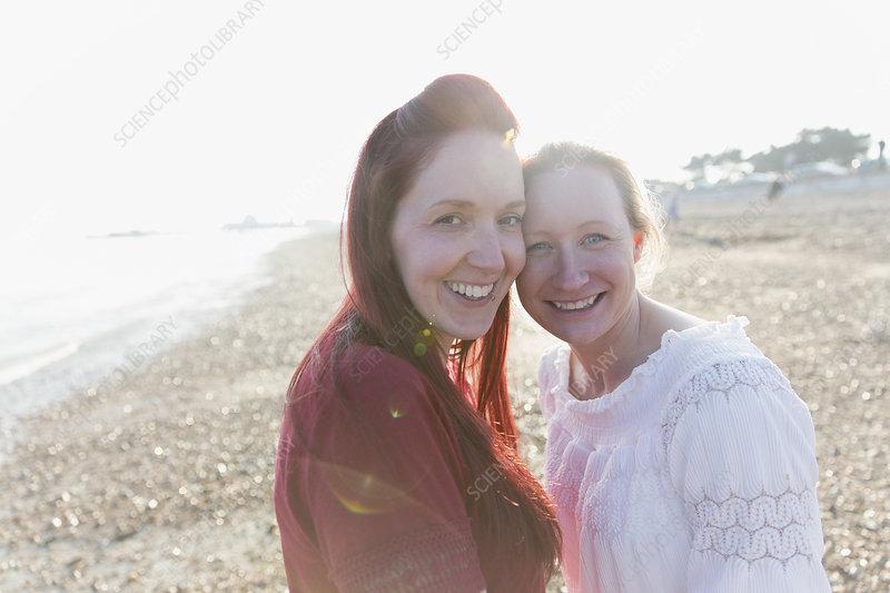 Portrait lesbian couple on beach