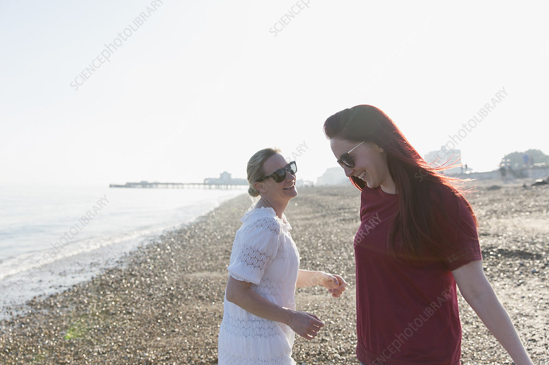 Happy lesbian couple on beach