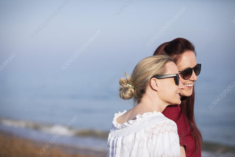 Lesbian couple on beach