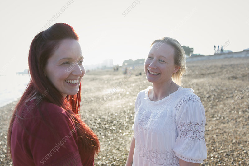 Happy lesbian couple on beach