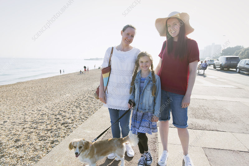 Portrait lesbian couple with daughter and dog