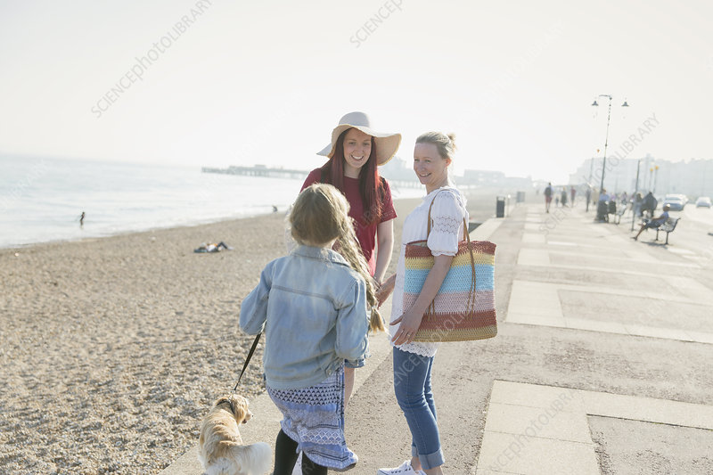 Lesbian couple with daughter and dog