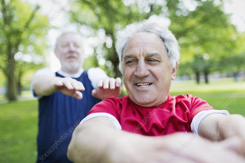 Active senior men exercising in park
