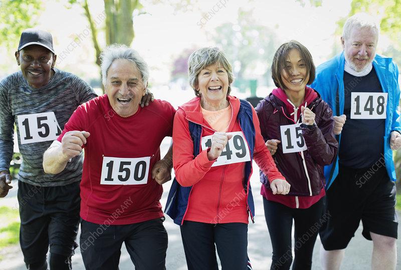 Active senior friends running sports race