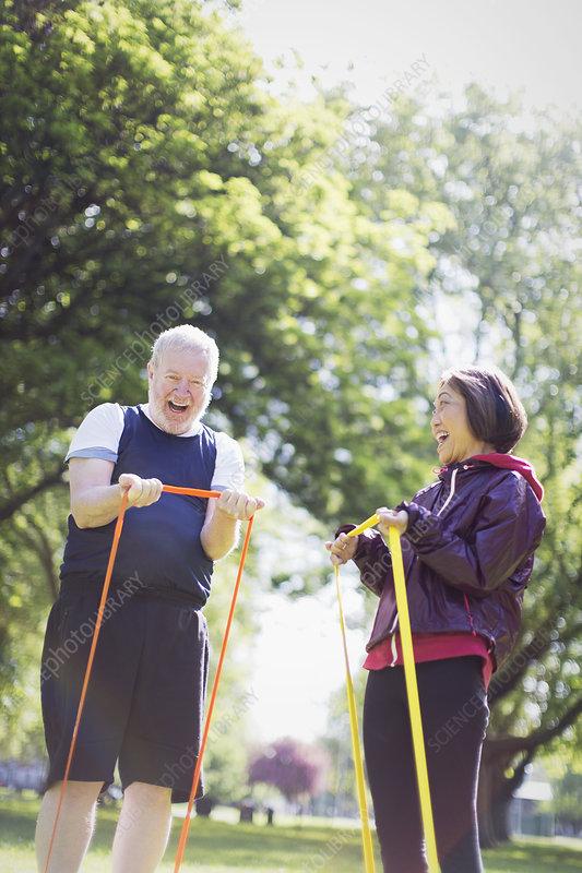 Enthusiastic active senior couple exercising