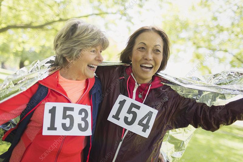 Active senior women finishing sports race