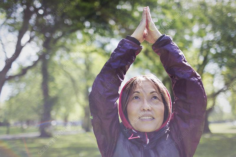 Active senior woman exercising, practicing yoga
