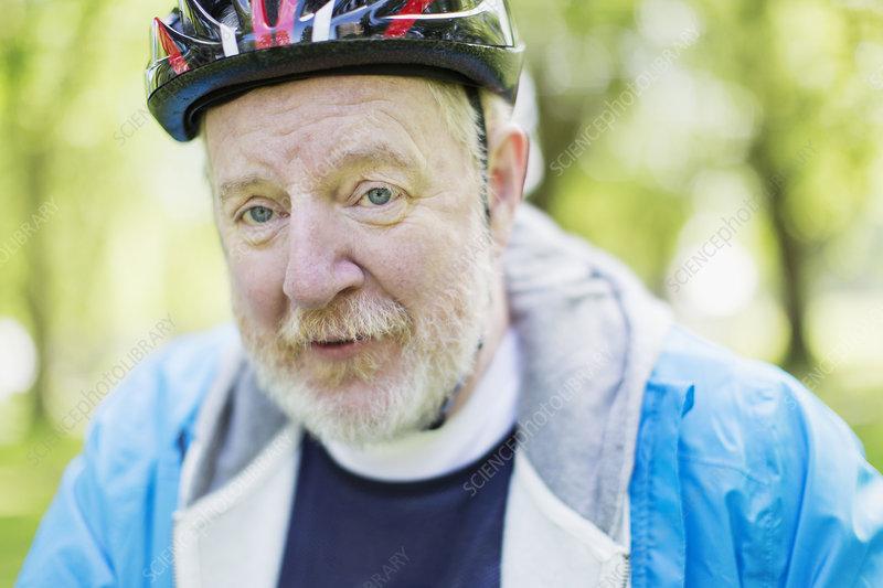 Portrait active senior man wearing bicycle helmet