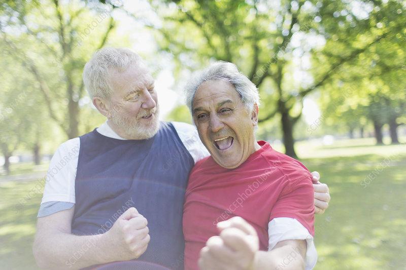 Active senior men friends cheering