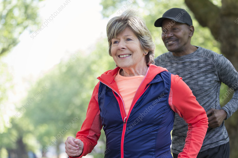 active senior woman power walking in park