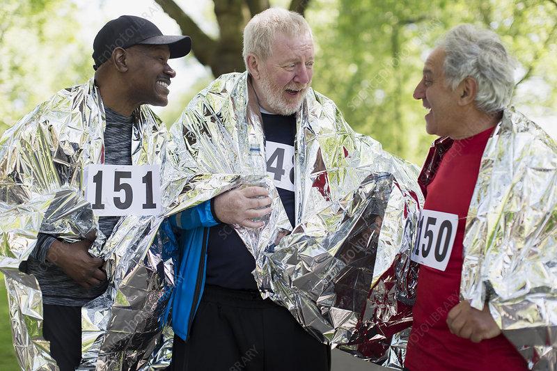 Active senior men friends finishing sports races