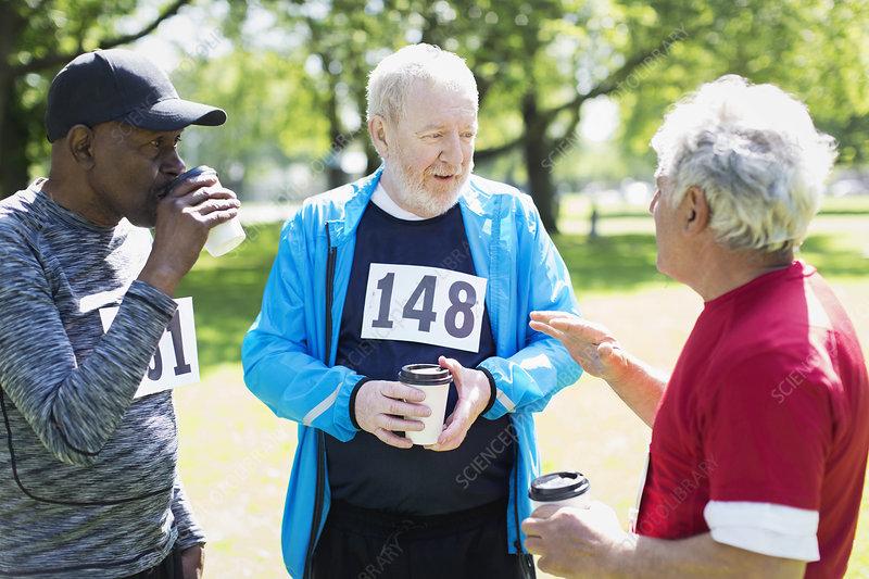 Active senior men friends finishing sports race
