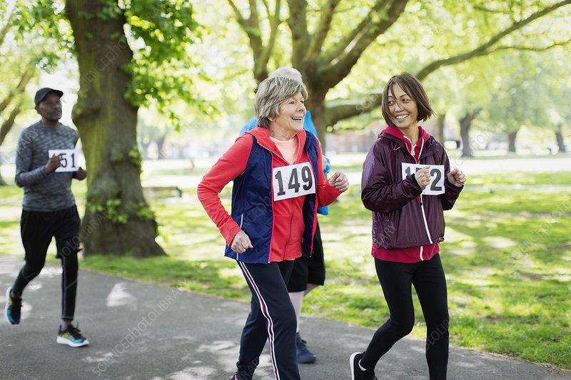 Active senior women friends power walking