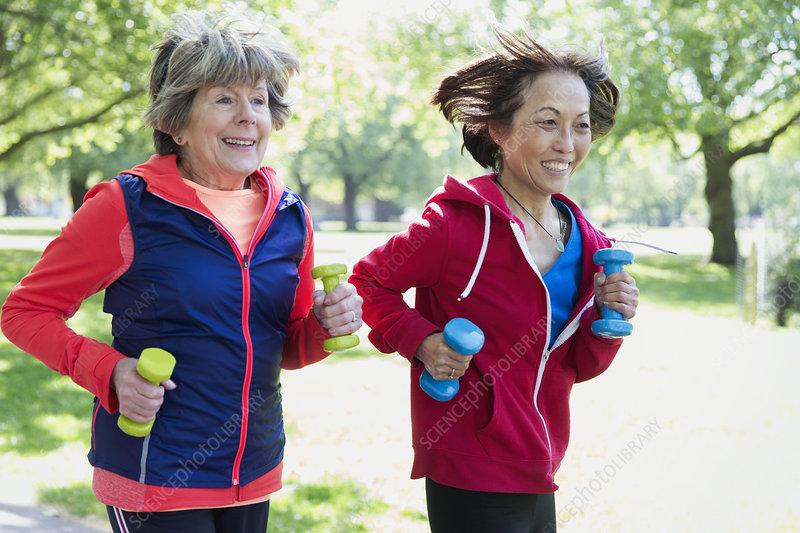 Active senior women friends jogging
