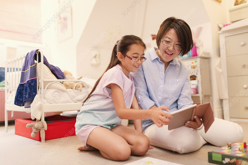 Mother and daughter using tablet