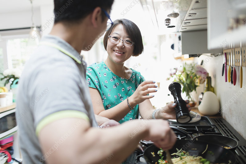 Couple cooking at kitchen stove