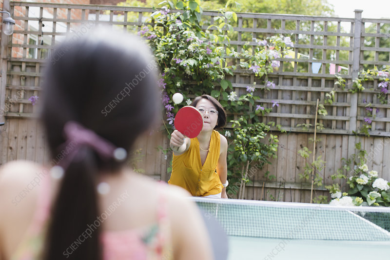 Mother and daughter playing table tennis