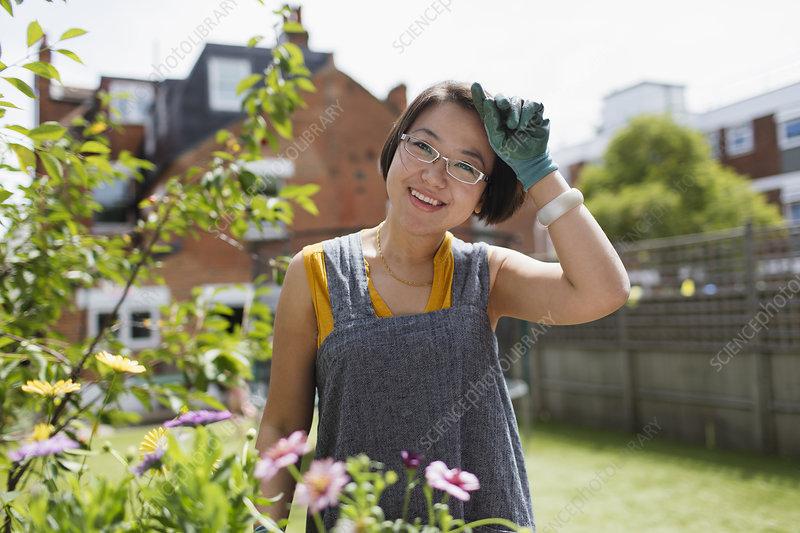 Portrait woman gardening in yard