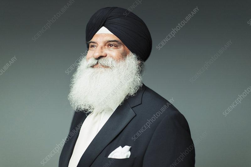 Portrait senior man with beard wearing turban
