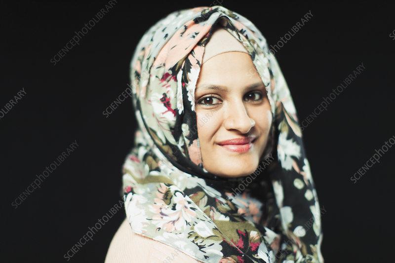 Portrait woman wearing floral hijab