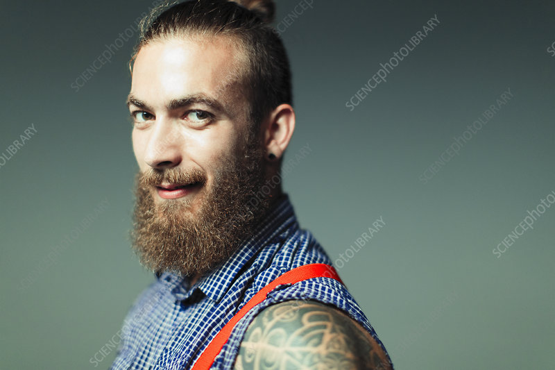 Hipster with beard and shoulder tattoo