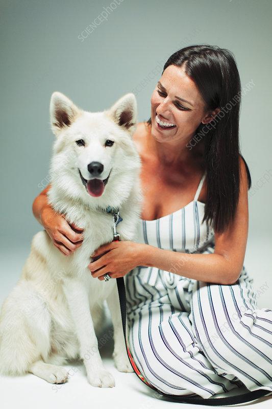 Portrait happy woman with dog