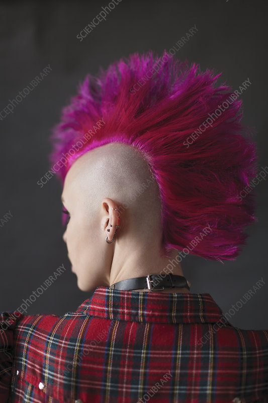 Cool young woman with pink mohawk