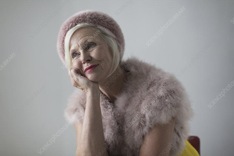nostalgic, elegant senior woman wearing fur