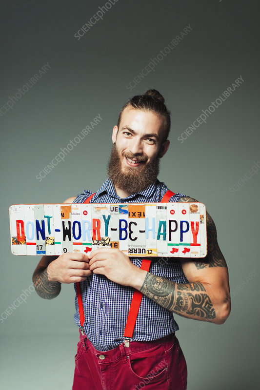 Portrait hipster man holding license plates